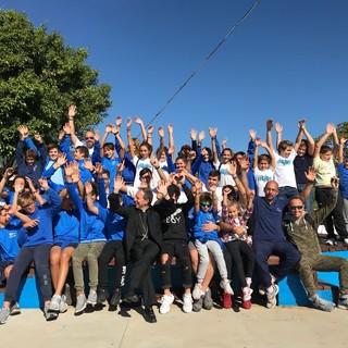 Foto di gruppo in occasione della visita del Vescovo Mons. Antonio Suetta